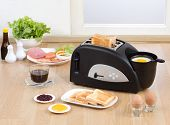 stock photo of multi purpose  - Multi purpose bread toaster with boiling and frying egg functions - JPG