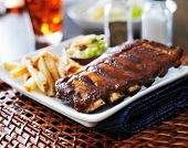 picture of baby back ribs  - full rack of baby back ribs in barbecue sauce - JPG