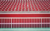 image of bleachers  - An Empty red bleachers at a stadium - JPG
