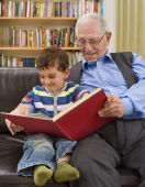 foto of storytime  - grandfather reading a story to his grandchild - JPG
