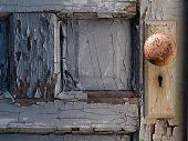 pic of mental_health  - Old door with peeling paint and a rusty doorknob - JPG