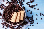 picture of shortbread  - Bowl of shortbread cookies and coffee beans on blue wooden background with jeans material - JPG
