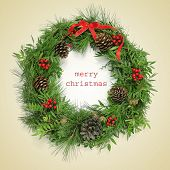 picture of christmas wreath  - a natural christmas wreath and the sentence merry christmas written on a beige background - JPG