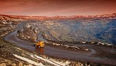 foto of iron ore  - Truck delivery by the motor transport of iron ore from a pit - JPG