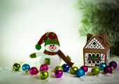 foto of gingerbread house  - gingerbread house over and lovely handmade snowman - JPG