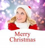 stock photo of shivering  - happy festive blonde against merry christmas - JPG