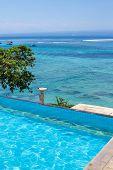 image of infinity pool  - Enjoy the ocean view infinity pool on vacation - JPG