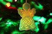 foto of christmas angel  - Knitted Christmas angel on Christmas lights background - JPG