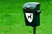 stock photo of defecate  - Dog waste plastic container in a park - JPG