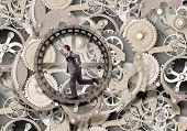 foto of hamster  - Young businessman in suit running in hamster wheel - JPG