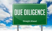 stock photo of diligent  - Highway Signpost with Due Diligence wording on Sky Background - JPG