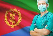 image of eritrea  - Surgeon with national flag on background  - JPG