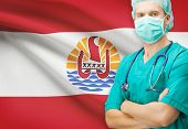 stock photo of french polynesia  - Surgeon with national flag on background  - JPG