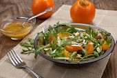 stock photo of mandarin orange  - Closeup of a plate of arugula salad with mandarins oranges beans sprouts and sliced almonds served with mandarin vinaigrette for healthy lunch - JPG