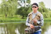 stock photo of catch fish  - Fishing in river - JPG
