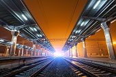 picture of passenger train  - Railway station at night - JPG