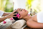 stock photo of thai massage  - Young woman receiving recreation Balinese massage in spa - JPG