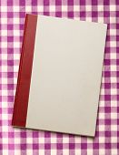 pic of blank check  - Blank paper notebook on the checked background - JPG