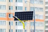 image of solar battery  - a Street lamp powered by solar batteries - JPG