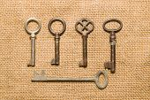 stock photo of hasp  - Five vintage keys to the safe on old cloth - JPG