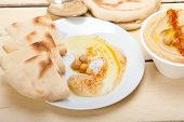 picture of pita  - traditional chickpeas Hummus with pita bread and paprika on top - JPG