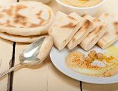 foto of pita  - traditional chickpeas Hummus with pita bread and paprika on top - JPG