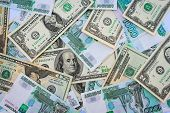 stock photo of depreciation  - Background different banknotes of us dollars and Russian rubles - JPG