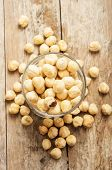 pic of hazelnut tree  - hazelnuts top view on wooden background close up - JPG