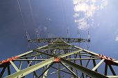 image of voltage  - Wide angle view of a high voltage line pylon and dark blue sky from below - JPG