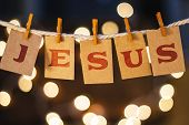foto of jesus  - The name JESUS printed on clothespin clipped cards in front of defocused glowing lights - JPG