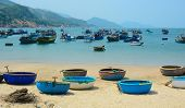 pic of coracle  - Picturesque sea landscape with tribal boats on beautiful beach - JPG