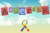 stock photo of aspergers  - Autism awareness ribbon against digitally generated grey background - JPG