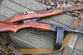 picture of box-end  - Russian World War II rifle and submachine gun on green wooden box - JPG