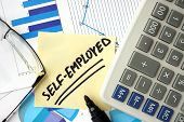 stock photo of self-employment  - Papers with graphs - JPG
