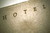 image of plaque  - Stone plaque on the facade of an old hotel - JPG