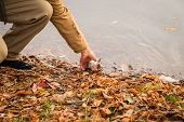 picture of fishermen  - Young fisherman fishing on the river bank - JPG
