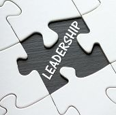 image of missing  - The word LEADERSHIP revealed on a blackboard by a missing jigsaw puzzle piece - JPG