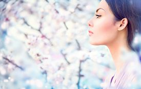 image of orchard  - Spring fashion girl outdoor portrait in blooming trees - JPG