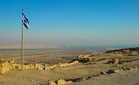 picture of masada  - Israeli flag on the wall of the fortress of Masada in Israel - JPG