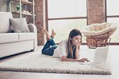 Serious Young Lady Is Studying, Lying On The Cozy Carpet In Living Room At Home, So Nice Modern Inte poster