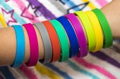Rubber Bands On Hand. Girls Hand With Bracelets Made Of Rubber Bands. Rainbow Loom Colored Rubber Ba poster
