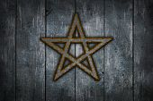 pic of pentacle  - rusty pentacle on wooden grunge background  - JPG