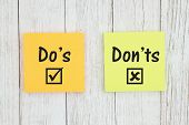 Dos And Donts On Two Sticky Notes  On Weathered Whitewash Textured Wood poster