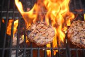 Hamburger. Hamburger grilled on a barbecue. Outdoor cooking. beef burger. ground meat cooking on bbq poster