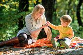Explore Nature Together. Mom And Kid Boy Relaxing While Hiking In Forest. Family Picnic. Mother Pret poster