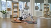 Woman Doing Exercises With Fitball In Fitness Gym Class. Engaging Core Abdominal Muscles. Image Conc poster