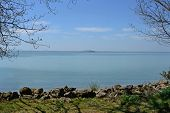 Scenic View Of The Rocky Coastline Of Polvese Island In Italiantrasimeno Lake, Umbria, Italy poster