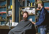 Hipster Client Got New Haircut. Barber With Hair Clipper Looking At Mirror, Barbershop Background. H poster