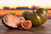 Group Of One Whole One Half One Slice Of Fresh Tomato Primora With Autumn Field In Background poster
