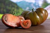Group Of One Whole One Half One Slice Of Fresh Tomato Primora With Country Nature In Background poster